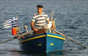 makrygialos-fisherman_and_barka_sea